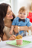 Baby Boy And Mother With Birthday Cake On Table — Stock Photo
