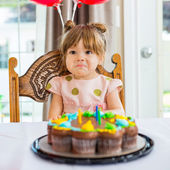 Birthday Girl Sitting In Front Of Cake — Stock Photo