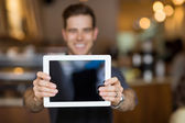 Cafe Owner Showing Digital Tablet — Stock Photo