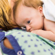 Babygirl Lying On Mother In Hospital — Stock Photo #35753015