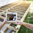 Carpenters Using Digital Tablet At Construction Site — Stock Photo #35754917
