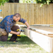 Carpenter Drilling Wood At Construction Site — Stock Photo #35755015