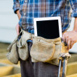 Construction Worker With Tablet Computer In Toolbelt — Stock Photo