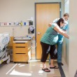 Nurse Comforting Tensed Pregnant At Window In Hospital Room — Stock Photo