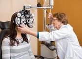 Optometrist Examining Young Woman's Eyes — Stock Photo