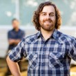 Manual Worker Smiling While Coworker Standing In Background — Stock Photo