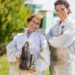 Stock Photo: Portrait Of Confident Female Beekeepers