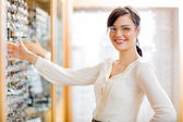 Female Customer Buying Glasses At Optician Store — Stock Photo