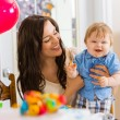Mother Holding Baby Boy At Birthday Party — Stock Photo #35843047