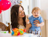 Mother Holding Baby Boy At Birthday Party — Stock Photo