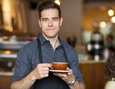 Barista with Coffee Cup — Stock Photo