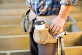 Disposable Coffee Cup And Hammer On Carpenter's Tool Belt — Stock Photo