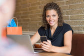 Portrait Of Woman Holding Mobilephone In Cafe — Stock Photo