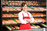 Beautiful Saleswoman Standing Arms Crossed In Butcher's Shop — Stock Photo
