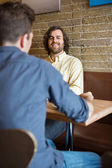 Man With Friend Sitting At Coffeeshop — Photo