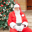 Man Dressed As Santa Claus Sitting In Front Of House — Stock Photo