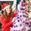 Beautiful Owner Decorating Christmas Tree At Store — Stock Photo