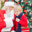 SantClaus Whispering In Boy's Ear — Stock Photo #35907047
