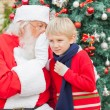 Santa Claus Whispering In Boy's Ear — Stock Photo