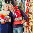 Couple Shopping In Christmas Store — Stock Photo