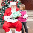 Santa Claus Giving Gift To Girl — Stock Photo