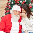 Santa Claus Listening To Girl's Wish — Stock Photo