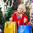 Beautiful Woman With Shopping Bags In Christmas Store — Stock Photo