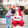 Girl And SantClaus Using Digital Tablet — Stock Photo #35907243