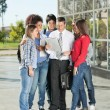 Students And Teacher With Book Standing On College Campus — Foto Stock