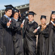 Graduate Students Holding Certificates On University Campus — Stock Photo