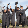 Students With Diplomas Celebrating Success On Graduation Day At — Stock Photo