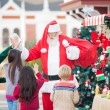Children Giving High Five To Santa Claus — Stock Photo