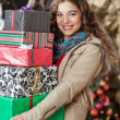 Woman Carrying Stacked Gift Boxes In Christmas Store — Stock Photo