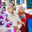 Senior Couple Shopping At Christmas Store — Stock Photo #35907683