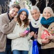 Happy Family Standing In Christmas Store — Stock Photo