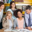 Teachers Discussing With Students In Library — Stock Photo