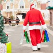 SantClaus With Bags Walking In Courtyard — Stock Photo #35908509