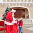 Boy Receiving Gift From Santa Claus — Foto de Stock