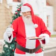 Santa Claus With Cookies And Milk — Stock Photo