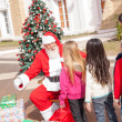 SantClaus Gesturing While Looking At Girl — Stock Photo #35908899
