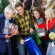 Stock Photo: Happy Family In Christmas Store