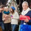 Happy Family With Presents At Christmas Store — Stock Photo