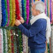 Senior Man Shopping For Tinsels — Stock Photo