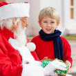 Boy Taking Present From SantClaus — Stock Photo #35909711