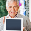 Happy Man Displaying Digital Tablet In Christmas Store — Stock Photo