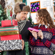 Couple With Christmas Presents In Store — Stock Photo #35909847