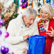 Surprised Couple Looking Into Shopping Bag — Stock Photo