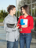 Students With Books Looking At Each Other On Campus — Stock Photo