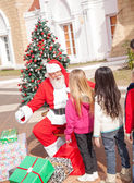 Santa Claus Gesturing While Looking At Girl — Stock Photo