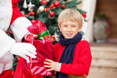 Boy Taking Gift From Santa Claus — Stock Photo